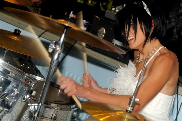 Claire Essertal plays the drums at her wedding